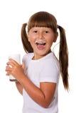 Muchacha que sostiene la leche Imagen de archivo libre de regalías