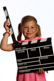 Muchacha que sostiene un clapperboard Imágenes de archivo libres de regalías