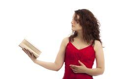 Muchacha que sostiene un libro Fotos de archivo libres de regalías