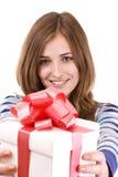 Muchacha que sostiene un regalo Imagenes de archivo