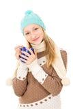 Muchacha que sostiene una taza Foto de archivo