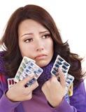 Muchacha que tiene gripe el tomar de píldoras Fotografía de archivo