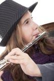Muchacha que toca la flauta Imagenes de archivo