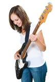 Muchacha que toca la guitarra baja aislada en blanco Fotografía de archivo libre de regalías