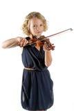 Muchacha que toca un violín en el fondo blanco Fotografía de archivo libre de regalías