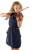 Muchacha que toca un violín en el fondo blanco Foto de archivo libre de regalías