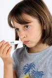 Muchacha que toma su temperatura Imagen de archivo libre de regalías