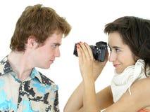 Muchacha que toma una foto del muchacho Foto de archivo libre de regalías