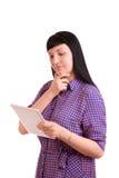 Muchacha que trabaja en una tableta Imágenes de archivo libres de regalías