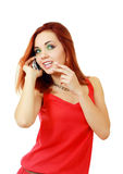 Muchacha que usa sonrisas del teléfono celular Foto de archivo