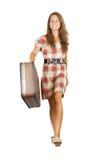 Muchacha que va con la maleta Fotografía de archivo