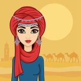 Muchacha árabe en un turbante en el desierto Imagenes de archivo