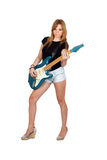 Muchacha rebelde adolescente que toca la guitarra eléctrica Foto de archivo libre de regalías