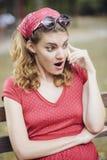 Muchacha retra roja chocada Fotografía de archivo libre de regalías