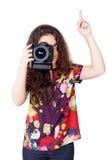 Muchacha rizada linda con la cámara aislada Imagen de archivo libre de regalías