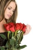 Muchacha roja de las rosas Fotos de archivo libres de regalías