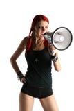 Muchacha roja del pelo con el megáfono Foto de archivo
