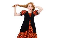 Muchacha roja del pelo en el vestido anaranjado aislado en blanco Fotos de archivo libres de regalías