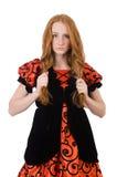 Muchacha roja del pelo en el vestido anaranjado aislado en blanco Fotografía de archivo