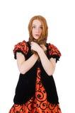 Muchacha roja del pelo en el vestido anaranjado aislado en blanco Foto de archivo