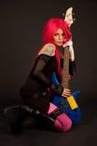 Muchacha romántica con la guitarra baja foto de archivo libre de regalías