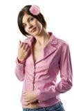 Muchacha rosada de la chaqueta con la flor Imágenes de archivo libres de regalías