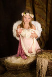 Muchacha rosada del ángel de la Navidad Imágenes de archivo libres de regalías
