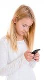Muchacha rubia agradable con el teléfono Fotografía de archivo