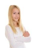 Muchacha rubia agradable con los brazos cruzados Imagen de archivo libre de regalías
