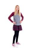 Muchacha rubia agradable en falda de tela escocesa Imagen de archivo