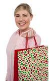 Muchacha rubia alegre que sostiene el bolso de compras Imágenes de archivo libres de regalías