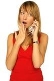 Muchacha rubia con el teléfono celular Fotos de archivo libres de regalías