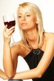 Muchacha rubia con el vidrio de vino Foto de archivo libre de regalías