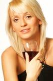 Muchacha rubia con el vidrio de vino Fotos de archivo libres de regalías