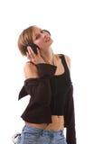 Muchacha rubia con los auriculares Fotos de archivo