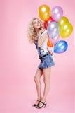 Muchacha rubia con los globos fotografía de archivo libre de regalías