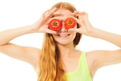 Muchacha rubia con los tomates Foto de archivo