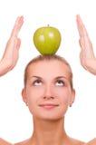 Muchacha rubia con una manzana Imágenes de archivo libres de regalías