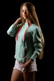 Muchacha rubia del adolescente en cazadora de la moda Imagen de archivo libre de regalías