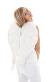 Muchacha rubia en blanco con las alas Imagen de archivo libre de regalías