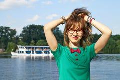 Muchacha rubia en el lago Imagen de archivo libre de regalías