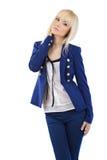Muchacha rubia en pantalones y chaqueta azules Fotos de archivo libres de regalías