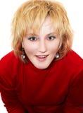 Muchacha rubia en rojo Foto de archivo libre de regalías