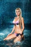Muchacha rubia en un bañador en el agua Imagen de archivo libre de regalías