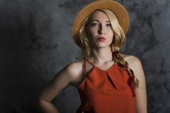 Muchacha rubia en un sombrero Imágenes de archivo libres de regalías
