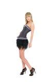 Muchacha rubia en una falda negra corta Imagen de archivo libre de regalías