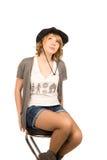 Muchacha rubia hermosa en un sombrero de vaquero Imágenes de archivo libres de regalías