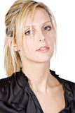 Muchacha rubia hermosa que mira en cámara Imagen de archivo libre de regalías
