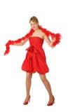 Muchacha rubia joven en alineada y boa rojas Imágenes de archivo libres de regalías