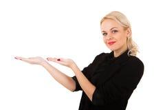 Muchacha rubia joven que lleva a cabo las manos Fotografía de archivo